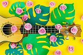 guitar and rose flowers pattern on vibrant   yellow background