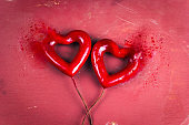 two red  hearts with dispersion effect