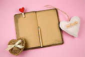 stuffed toy heart and vintage paper open notebook