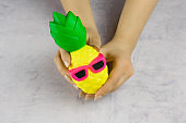 woman hands with anti stress toy pineapple