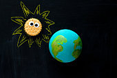homemade model of the Earth planet on a chalkboard