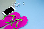 top view flat lay smartphone and pink flip flops