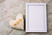 top view empty white wooden frame and fabric soft toy