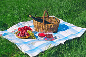red wine and fruit basket