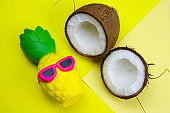 funny pineapple toy in sunglasses and coconut
