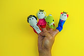 male hand wearing 4  finger puppets