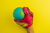 dinosaur nibbling   model of the Earth planet , concept of global cataclysm