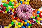 sweet colourful candies, cookies and donuts top view