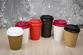 set of cups of take away coffee  on a wooden table