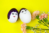 egg painted in man and woman funny cute faces