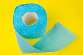 blue  toilet paper on a yellow background