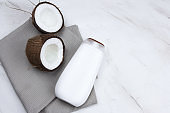 coconut and mock up white  plastic  bottle  on a  marble background