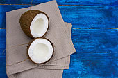 coconut on a blue background copy space