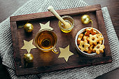 winter holiday breakfast tea,honey and star cookies on a wooden tray