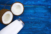 coconut and mock up white  plastic  bottle  on a  blue background