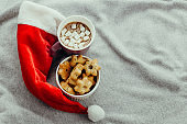 starshaped cookies,hot chocolate and Santa Claus red hat
