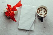 gift box, blank notebook, pen and hot chocolate, winter holidays cheklist or to do list