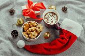 star shaped cookies,hot chocolate,gift box  and Santa Claus red hat