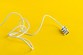 white USB Micro cable isolated on yellow background
