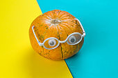 little funny pumpkin with eyes in glasses