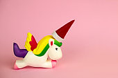 squishy unicorn toy with Santa Claus hat  on its horn