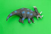 dinosaur toy on green background