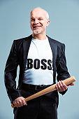 Gleeful Boss standing wielding a baseball bat