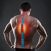 Pain in the spine, a man with backache, injury in the human back, chiropractic treatments concept