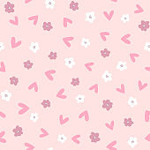 Cute seamless pattern with scattered flowers and hearts. Girly print. Vector illustration.