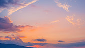 Beautiful sunset sky with clouds, mountain view