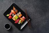 Overhead image of variety of sushi and rolls served on a plate. Shrimp, unagi, crab, salmon and tuna