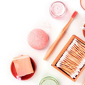 Plastic-free, zero waste products, flat lay on a white background with a place for text. Bamboo toothbrush and cotton swabs, konjac sponge, etc, overhead square shot