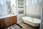 Master Bathroom In a Large Home with Vaulted Ceilings and wood cabinets