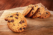 Chocolate chip cookie, gluten free, a close-up on a dark rustic background with a place for text