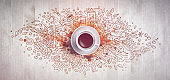 Coffee concept on wooden background - white coffee cup, top view with doodle illustration about coffee, beans, morning, espresso in cafe, breakfast. Morning coffee illustration. Hand draw and coffee illustration