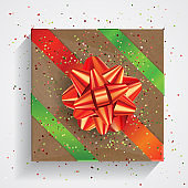 Brown gift box with big red bow and red and green ribbons isolated on white background. Christmas and Birthday package, selebration realistic gift box, top view