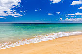 Blue ocean wave on sandy beach. Soft wave of blue ocean on sandy beach. Background. Top view of Beautiful beach with tranquil wave, sea and ocean background, summer vacation concept.