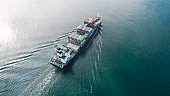 Large container ship at sea. Aerial top view of cargo container ship vessel import export container sailing.