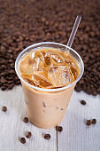 Iced coffee with ice and coffee beans
