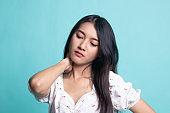 Young Asian woman got neck pain