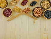 Top view assorted beans on wooden background