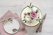 Fresh flowers decorated white cake