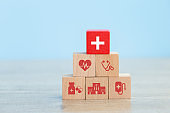 Health Insurance Concept arranging wood block stacking with icon healthcare medical.