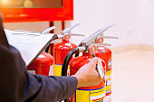 Male Professional inspection Fire extinguisher,safety concept.