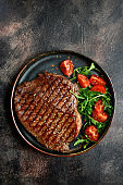 Roasted organic rancho beef steak with vegetables salad and garlic sauce