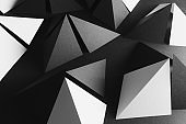 Background with geometric shapes of paper, black and white abstract
