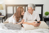 Happy Asian Senior Couple  lifestyle after retiree concept,Lovely elderly couple on bed
