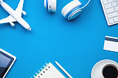 Travel items on a blue background. Travel and vacation. Business trip concept