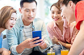 friends watch smart phone