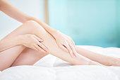 Beauty woman touch her leg